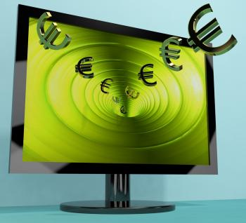 Euro Symbols From Computer Screen Showing Money Investments And Winnin