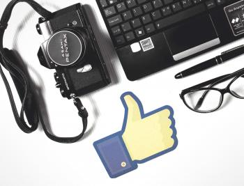 Facebook Thumbs-Up with Laptop and Camera