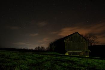 Farm House at Night Under Sky Filled with Stars