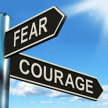 Fear Courage Signpost Shows Scared Or Courageous