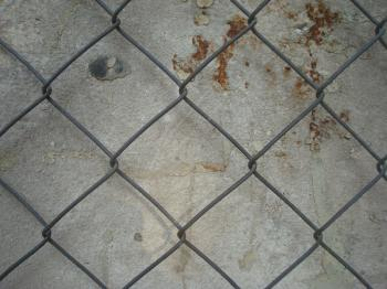 Fenced concrete wall texture