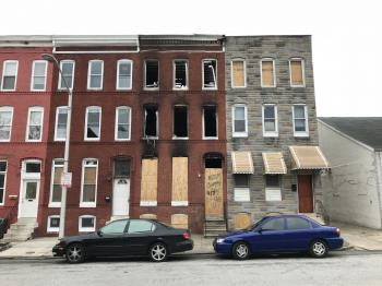 Fire-damaged vacant rowhouse, 417 E. 21st Street, Baltimore, MD 21218