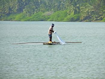 Fisherman in a log boat