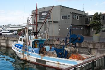 Fishing vessel in front of restaurant