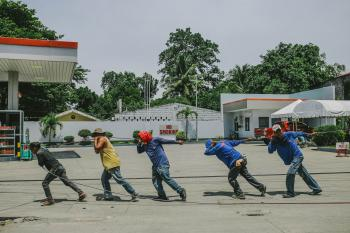 Five Men Pulling Black Rope