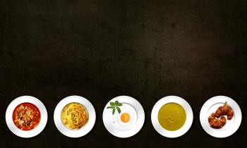 Five White Plates With Different Kinds of Dishes