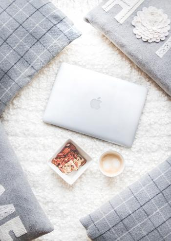 Flatlay Photography of Macbook and Snacks