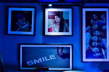 Four Assorted Photo Frames With Photos
