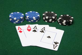 Four of a kind aces with poker chips