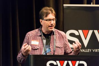 Frank Nora (developer of Nightstation, representing New York City VR Meet-Up) giving 60 Second Pitch at SVVR (eyes closed and closing both hands)