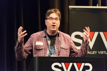 Frank Nora (developer of Nightstation, representing New York City VR Meet-Up) giving 60 Second Pitch at SVVR (eyes/mouth open wide and hands raised)