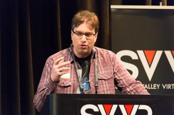 Frank Nora (developer of Nightstation, representing New York City VR Meet-Up) giving 60 Second Pitch at SVVR (one hand raised)