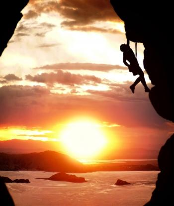Free-climber rising at sundown