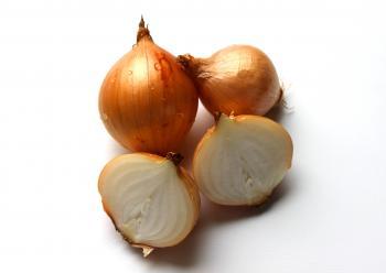 Fresh onion bulbs isolated on white back