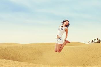 Full Length of a Woman Standing in a Desert