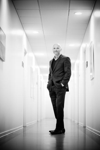 Full Length Portrait of Man Standing in Corridor