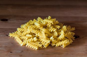 Fusilli pasta on a old wooden background