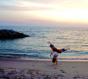 Girl Handstand on the Beach