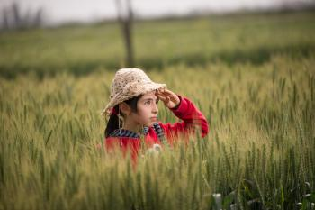 Girl in Red Hoodie Wearing Beige Sunhat