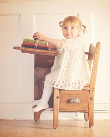 Girl in White Dress Sitting on Brown Wooden Chair
