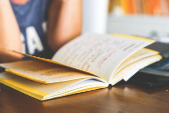 Girl reading a notebook
