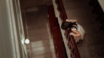 Girl Standing Beside Wall