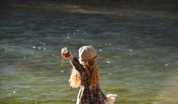 Girl Throwing Stone