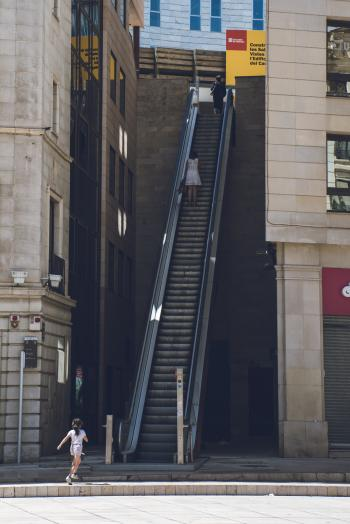 Girl Walking Towards the Escalator