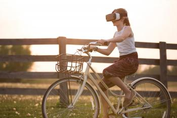 Girl Wearing Vr Box Driving Bicycle during Golden Hour