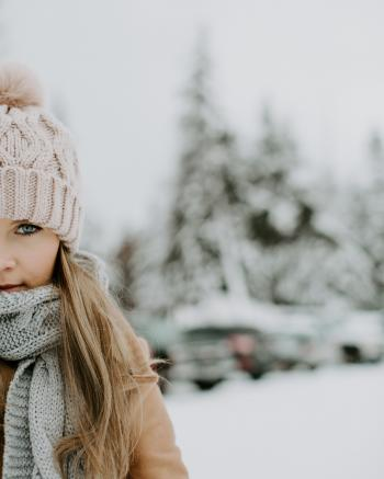 Girl Wearing Winter Outfit on Snowy Field
