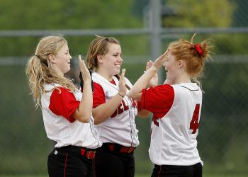 Girls on White Red Jersey Playing Hand Game