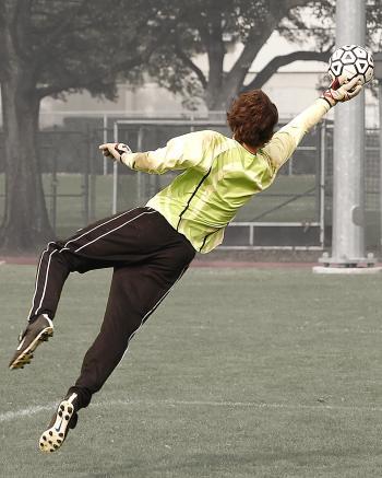 Goalee Player Holding Black and White Soccer Ball