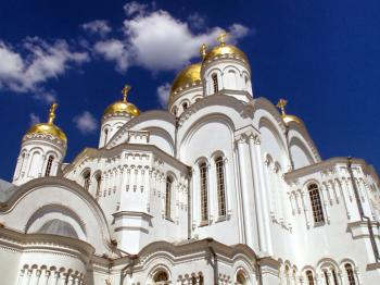 Gold and White Dome Building Under White Cumulus Clouds and Blue Sky