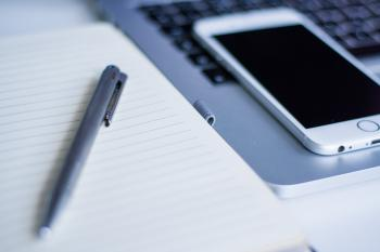 Gray Click Pen on White Notebook Beside Silver Iphone 6