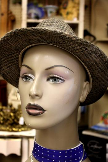 Gray hat on a mannequin