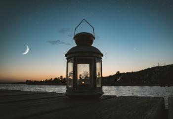 Gray Metal Candle Lantern on Boat Dock