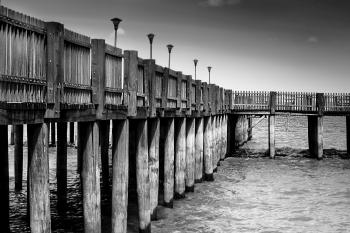 Gray Scale Photo of a Dock