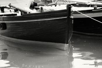 Gray Scale Photo of Boat on Body of Water