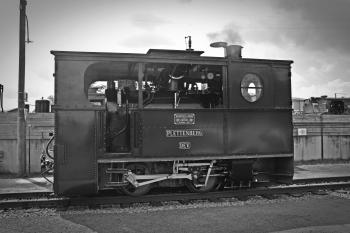 Gray Scale Photo of Classic Train
