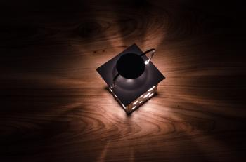 Gray Steel Candle Lantern on Brown Wooden Board