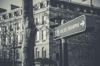Grayscale Photo of Black and White Arc De Triomphe Street Sign