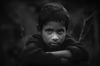 Grayscale Photo of Boy in Long-sleeved Shirt