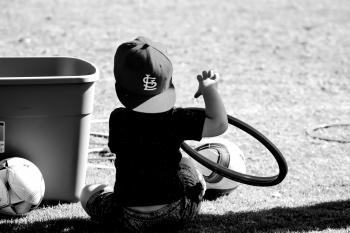Grayscale Photo of Boy Wearing St. Louis Cap