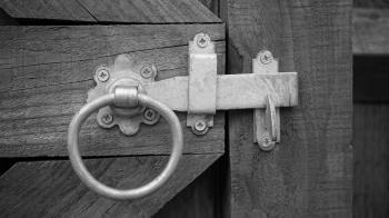 Grayscale Photo of Door Knock