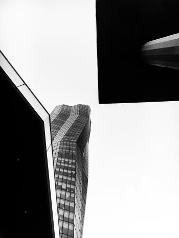 Grayscale Photo of Glass Curtain High Rise Building