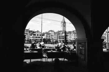 Grayscale Photo Of People In A Cafe