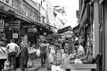 Grayscale Photo of People in the Market