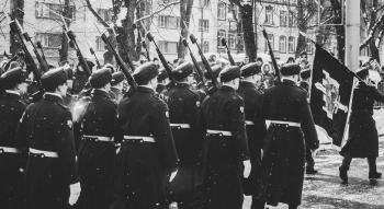 Grayscale Photo of Soldiers Matching