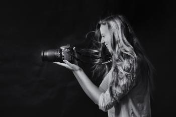 Grayscale Photo of Woman Using Dslr Camera