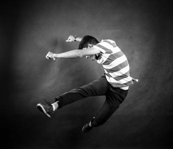 Grayscale Photograph of Man Wearing White and Black Stripe Crew Neck T Shirt